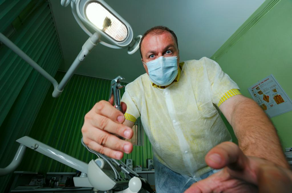 Scary dentist wielding tools