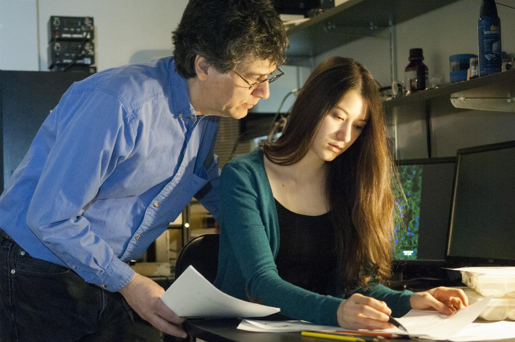 Elana Simon with her father, Dr. Sanford Simon doing research together.