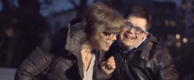 Man with Down syndrome and his mom laughing and hugging