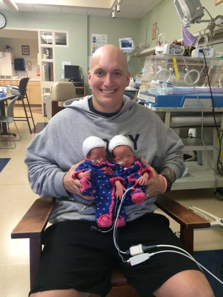 Brandon holding daughters at hospital