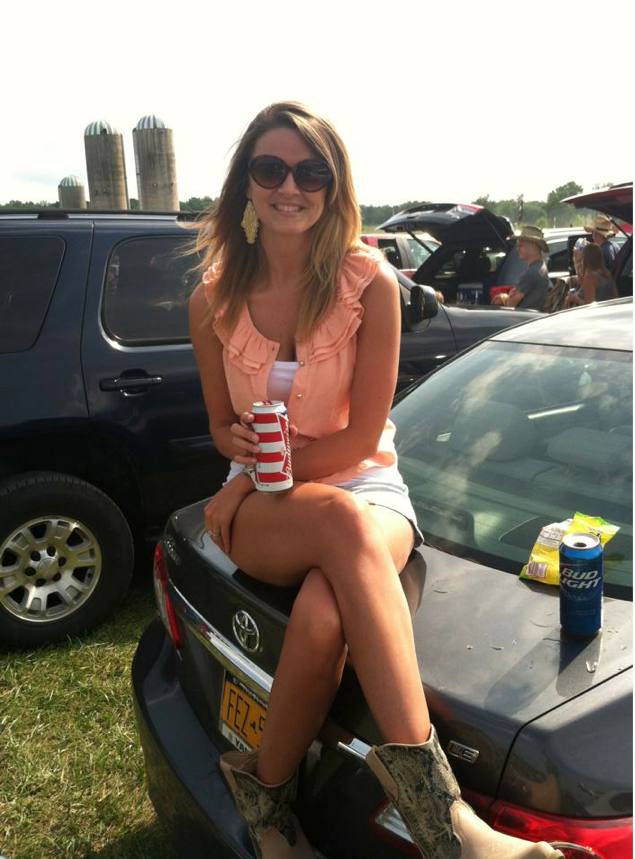 Jenna outside in top of car drinking