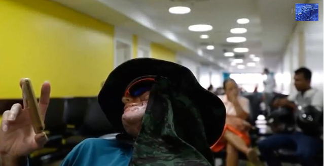 Jardim wears hat and scarf to camouflage at hospital