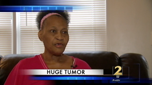 Woman with tumor talking on TV