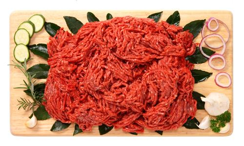 Ground beef on wooden board