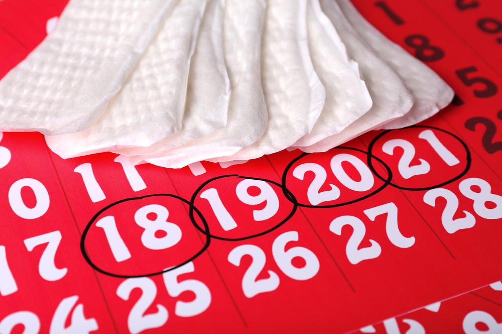 Sanitary pads on red calendar