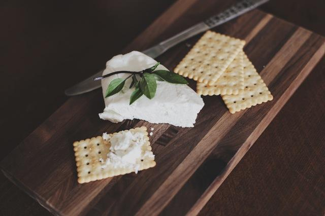 Cheese and crackers on chopping board