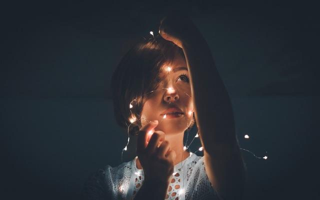 Woman with lights on face