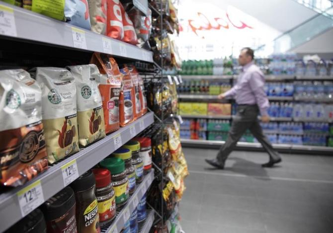 The coffee section is seen in a new Walgreens store in Chicago January 9, 2012.