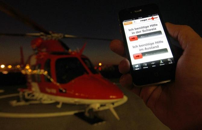 "A spokesperson of Swiss air rescue (REGA) shows the new ""iRega"" iPhone rescue application at Zurich Airport in Kloten, February 8, 2011."