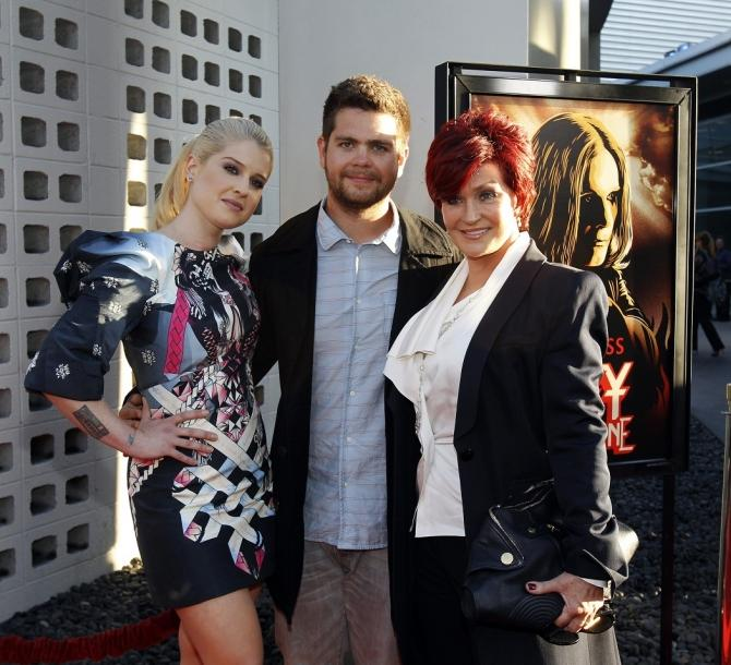 "Jack Osbourne (C) poses with his mother Sharon Osbourne (R) and his sister Kelly Osbourne at a private preview of the documentary ""God Bless Ozzy Osbourne"" at the Arclight Cinerama Dome in Hollywood, California August 22, 2011"