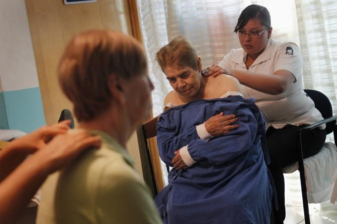 Alzheimer's patients are seen during a massage session inside the Alzheimer foundation in Mexico City April 19, 2012.