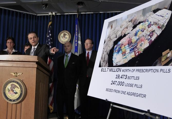 Preet Bharara, U.S. Attorney for the Southern District of New York, speaks as Ray Kelly (2nd R) NYPD Commissioner, and Robert Doar (R), Commissioner of the New York City Human Resources Administration look on during a news conference announcing the unseal
