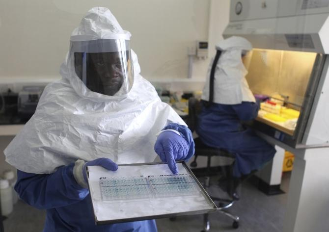A doctor displays collected samples of the Ebola virus at the Centre for Disease Control in Entebbe, about 37km (23 miles) southwest of Uganda's capital Kampala, August 2, 2012. Residents in western Uganda said on Thursday they were too scared to go shop