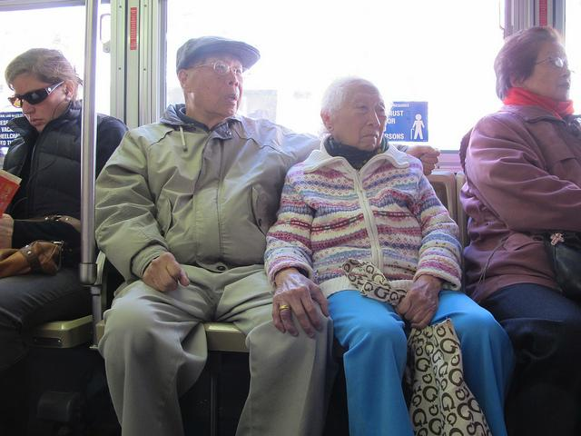 Elderly Couple on Bus
