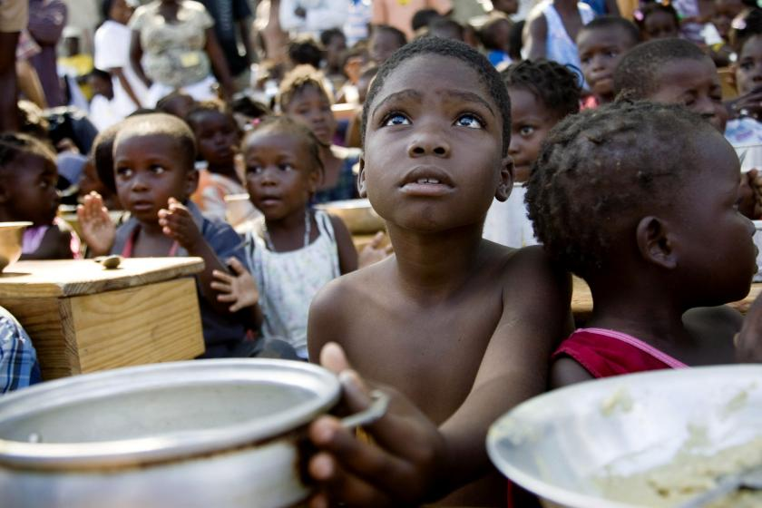 A child awaits for the distribution of meals, hunger