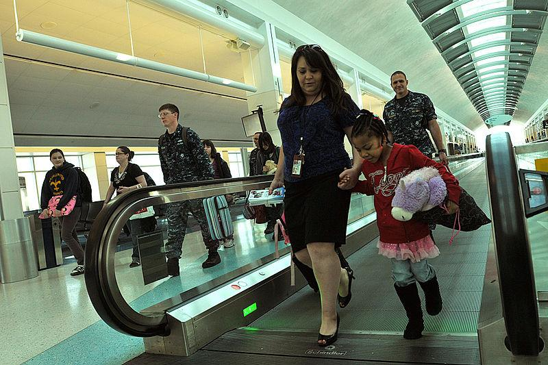 Woman and child in airport