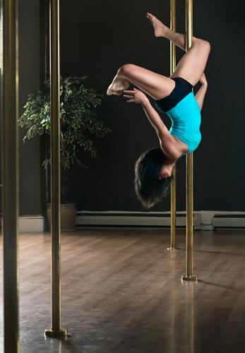 Woman doing pole dancing fitness