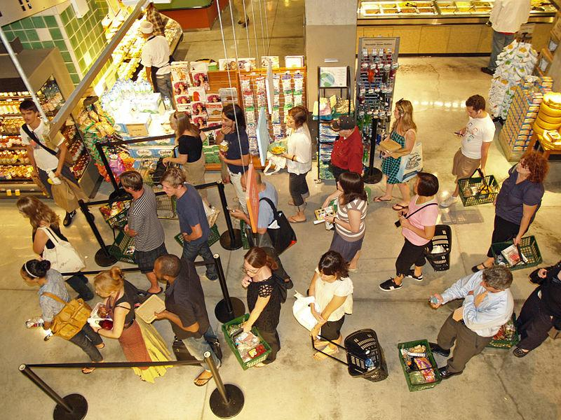 Standing in line at food store