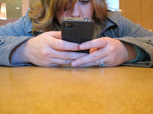 Girl texting in class