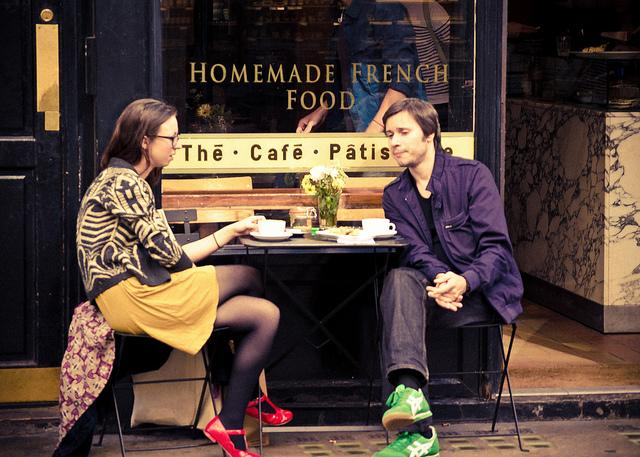 Couple sitting in front of restaurant