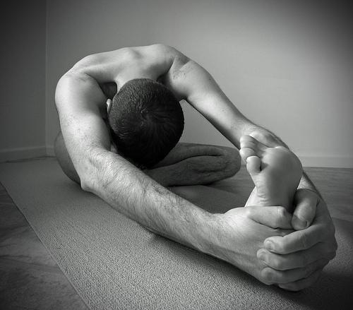 Man stretching on floor