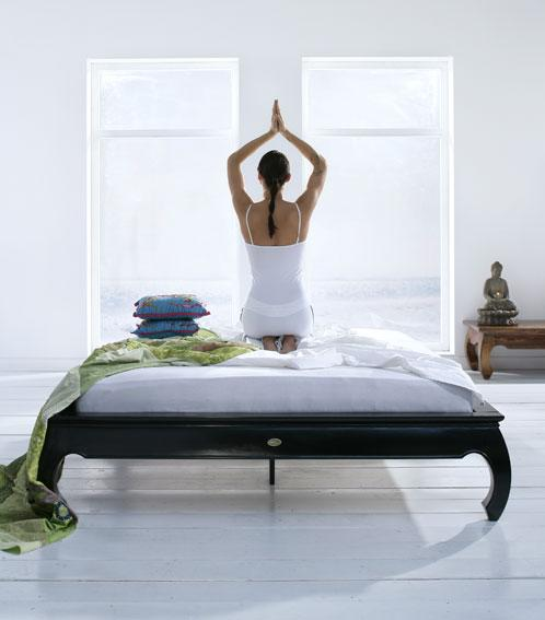 Woman on bed stretching