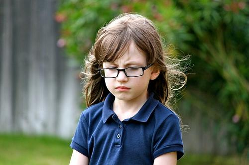 Girl with glasses pouting