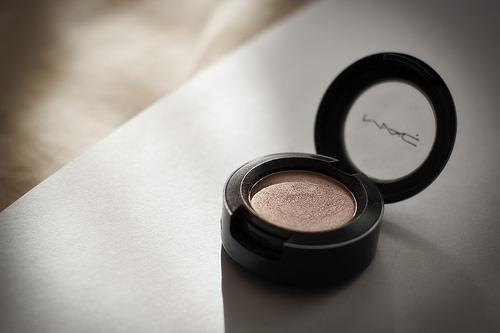 MAC cosmetics on table