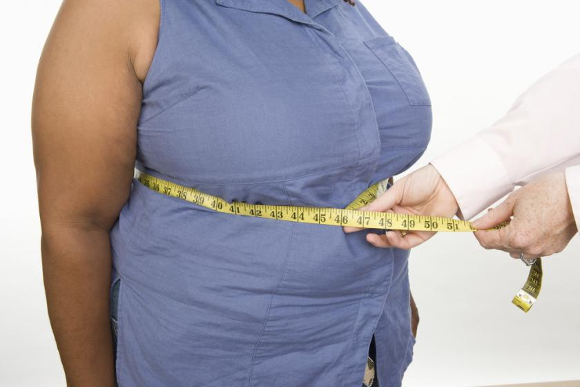 Obese woman being measured