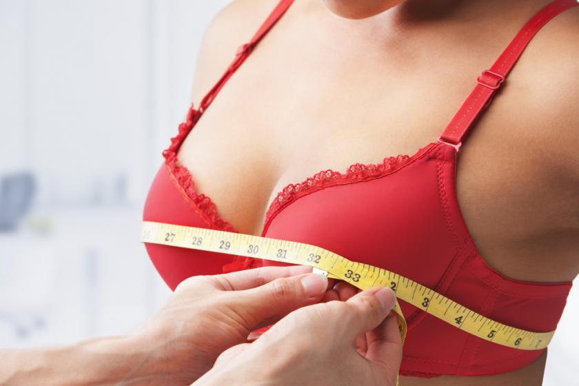 Woman getting measured for bra size