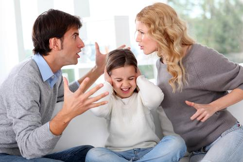 Couple fighting in front of child
