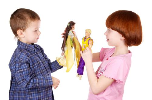 Brother and sister playing dolls