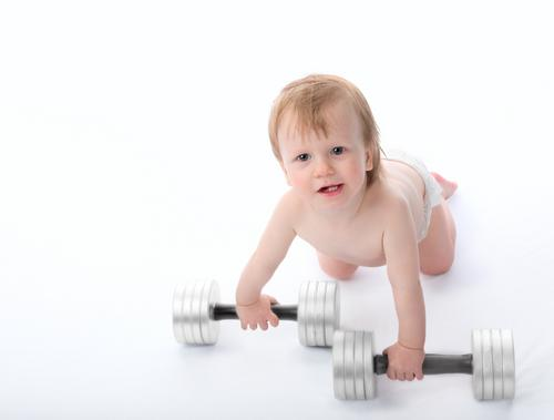Baby lifting dumbbells