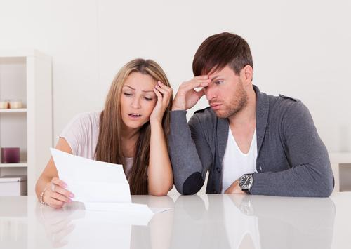 Couple stressed reading letter