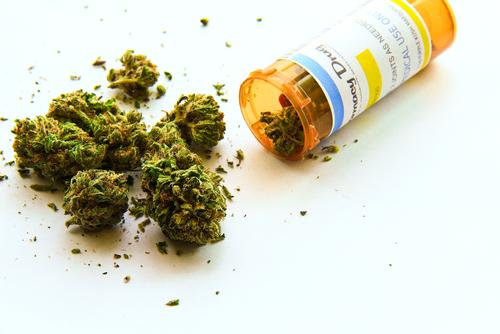 Medical marijuana pouring out of prescription bottle