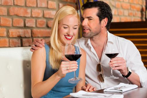 Man and woman on a date drinking wine at a restaurant