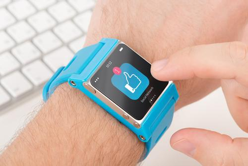 Male finger taps on blue smartwatch icon