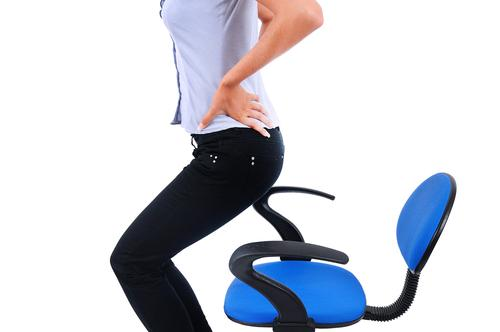Woman has backache from sitting too long