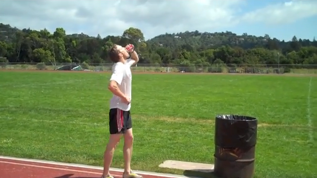 Man beats beer mile world record