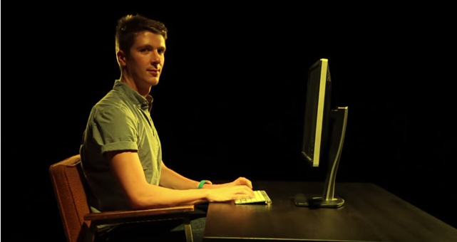 Guy sitting on chair with legs crossed