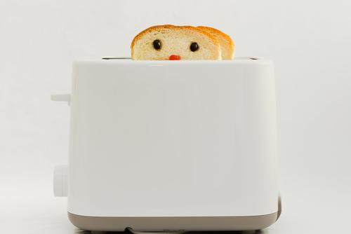 Bread coming out of toaster