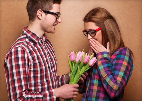 Guy giving woman bouquet