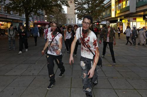 People dress as Zombies and scare people