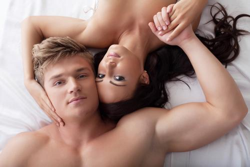 Couple hugging each other on bed