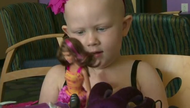 Grace plays with 'chemo Barbie'
