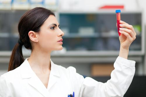 Woman researcher doing a blood test in a laboratory