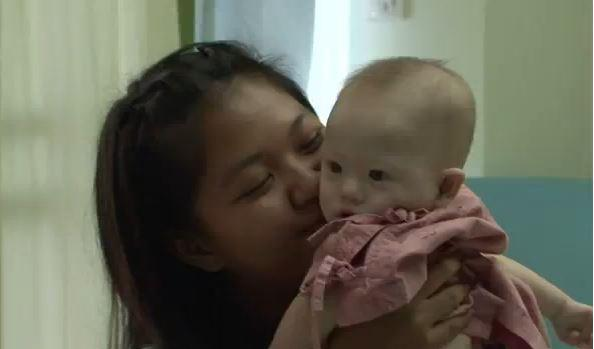 Surrogate Mother Takes Care Of Disabled Baby Left Behind