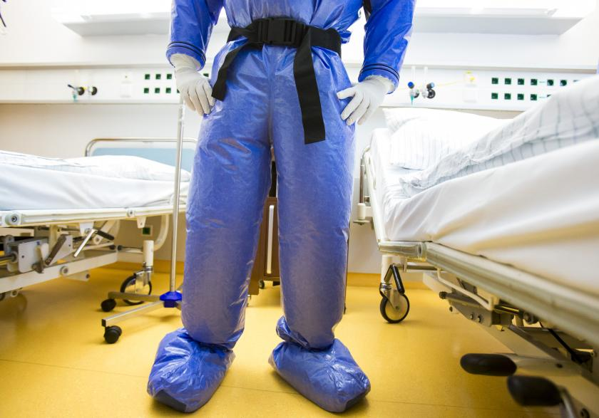 medical professional in 'space suit'