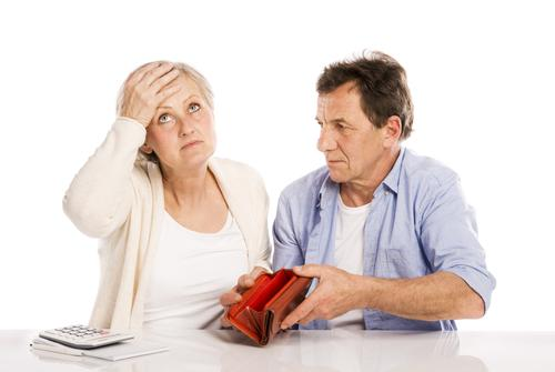 Couple with empty wallet discussing financial issues