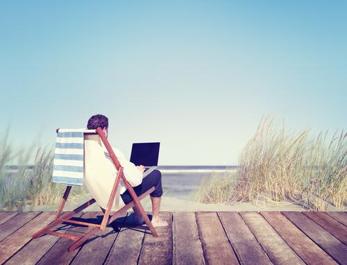 Woman working from the beach
